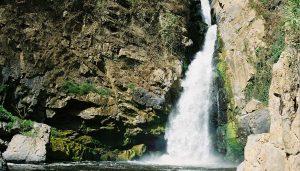 Waterfall and rock wall
