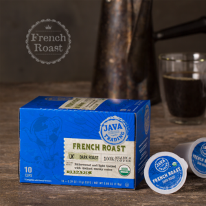 Box of 10 count of Organic French Roast coffee on a wooden table with metal kettle