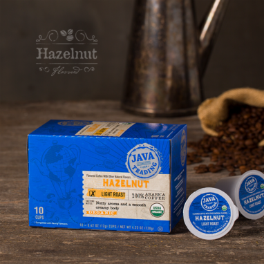 Box of 10 count of Organic Hazelnut coffee on a wooden table with metal kettle