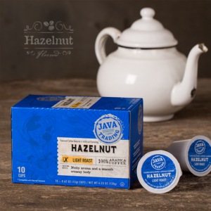 Box of 10 count of Hazelnut flavored coffee on a wooden table with white kettle