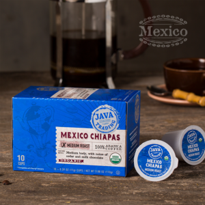 Box of 10 count of Organic Mexico Chiapas coffee on a wooden table with french press