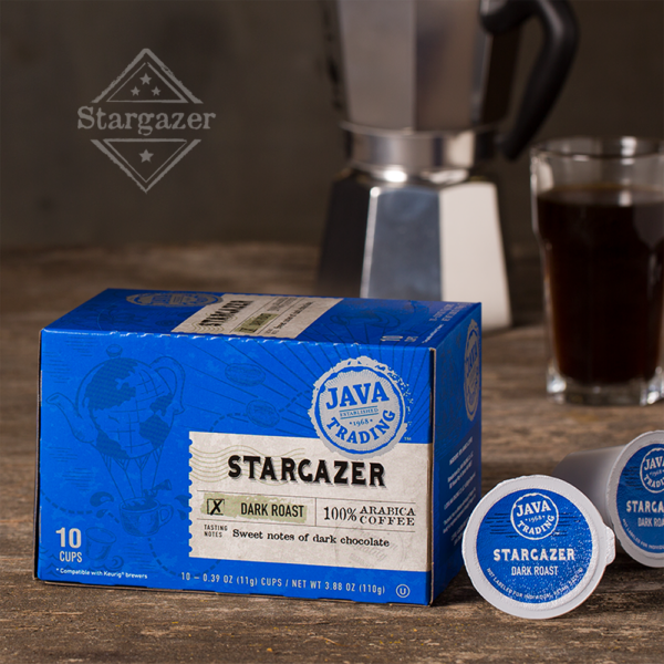 Box of 10 count of Stargazer blend coffee on a wooden table with mocha maker and glass of coffee