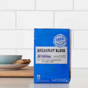 Box of 10 count Breakfast Blend coffee on a kitchen counter with cookie