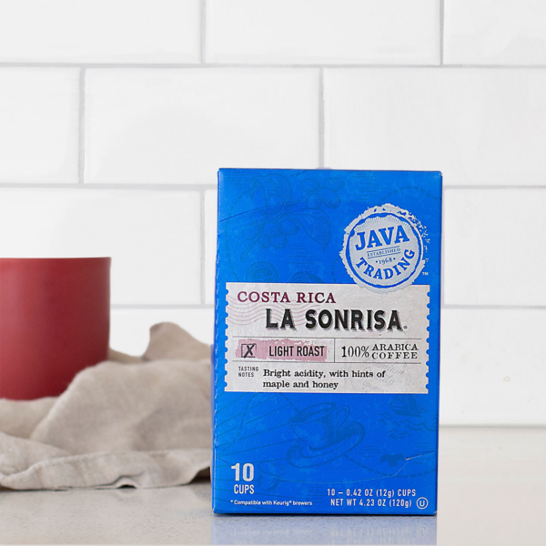Box of 10 count Costa Rica La Sonrisa box on a kitchen counter with red cup