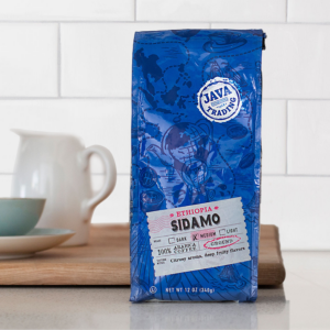 Bag of 10 ounce Ethiopia Sidamo on a kitchen counter with small pitcher