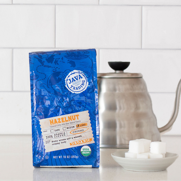 Bag of 10 ounce Organic Hazelnut on a kitchen counter with a kettle and sugar cubes