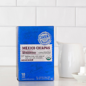 Box of 10 count Organic Mexico Chiapas box on a kitchen counter with small pitcher