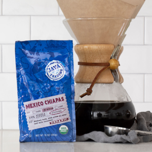 Bag of 10 ounce Organic Mexico Chiapas on a kitchen counter with a pour over brewer