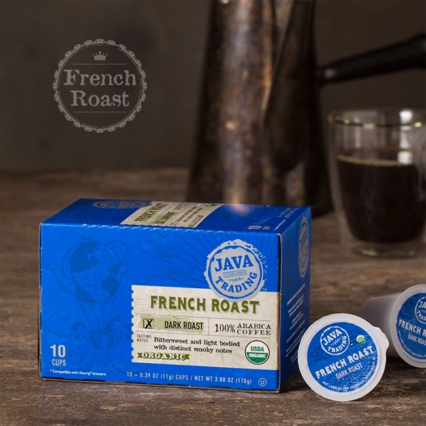 Box of 10 count of COrganic French Roast coffee on a wooden table with metal pitcher