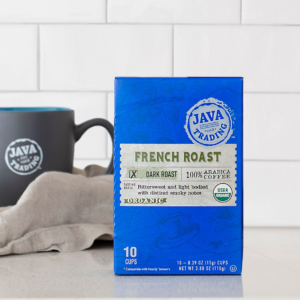 Box of 10 count of COrganic French Roast coffee on a kitchen counter with mug