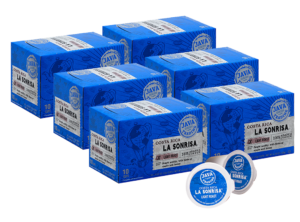 6 blue boxes of Java Trading Costa Rica La Sonrisa k-cups organized in two rows