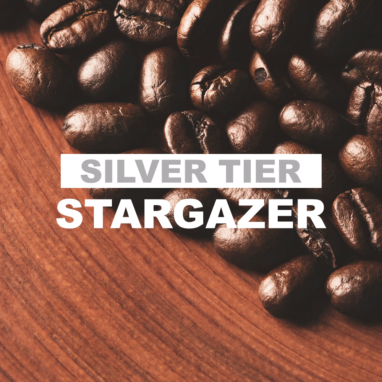 """dark roasted coffee beans over wooden plate with overlay of word """"silver tier stargazer"""""""