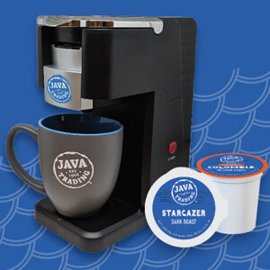 Single cup coffee brewer with Java Trade logo and mug, and two k-cups on blue background