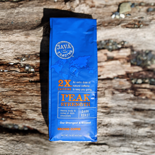 Bag of Java Trading Peak Strenght High Caffeine 16 ounces ground coffee on a wooden background